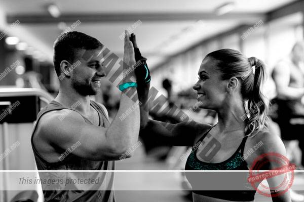 Two personal trainers celebrating success