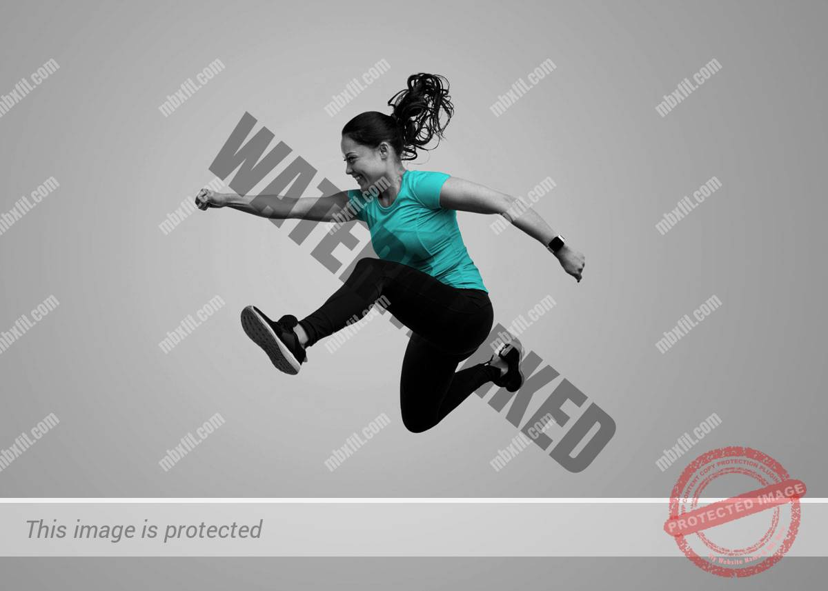 Female personal trainer jumping high